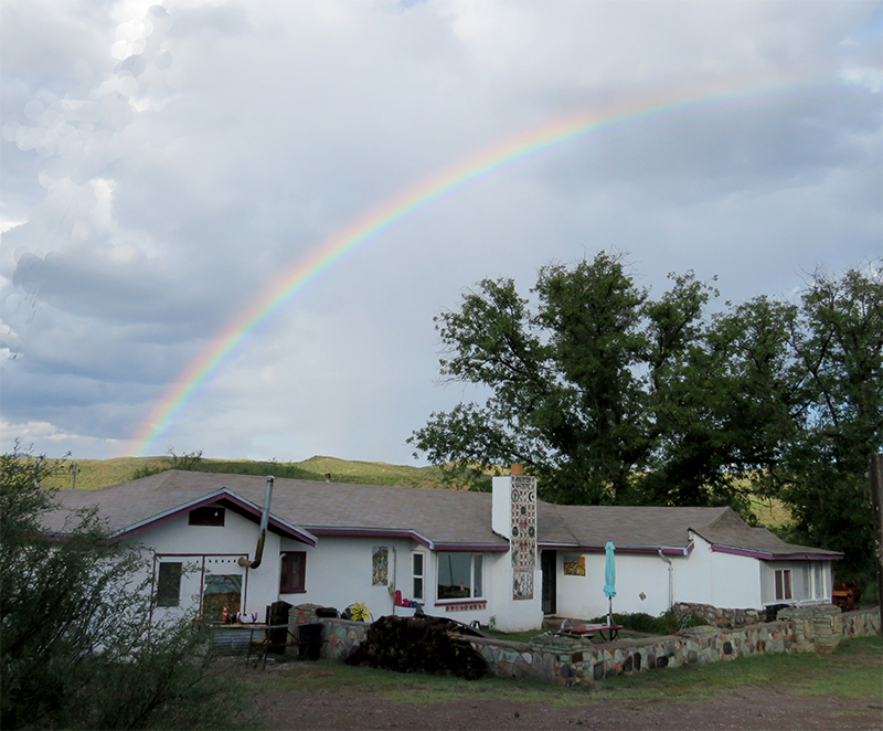 Photo of the Peyote Way Church Congregation House with rainbow overhead